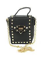 Черная женская сумочка клатч с золотыми шипами