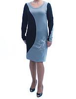 Женственное платье полуприлегающего силуэта из красивой ткани с цветными вставками большого размера.