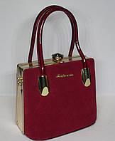 Стильная женская лако-замшевая сумка-Ридикюль с рамочным замком красного цвета