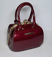 Стильная женская лаковая сумка-Ридикюль Marino Rose с рамочным замком красного цвета