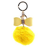 Брелок для сумок и ключей Бумбон с жёлтым кожаным бантом Кролик, белые стразы, металл под золото
