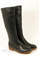 Женские кожаные сапоги на низком каблуке