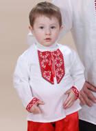 Вышиванка для новорожденного. С синей, красной и молочной вышивкой