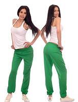Штаны на резинке с карманами зеленого цвета