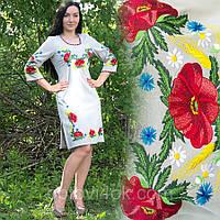 Льняное вышитое платье с распорками