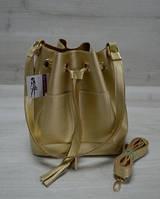 Молодежная сумка из эко-кожи  Люверс  золотого цвета 23107