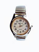 Часы кварцевые на  браслете резинка под золото