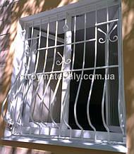 Выгнутая решетка с элементами ковки. Производятся такие решетки только из квадрата 12 мм.
