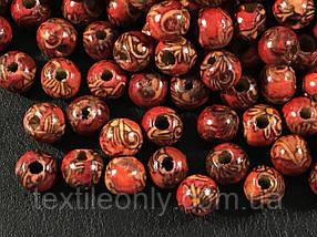 Дерев'яні намистини 9 мм червоний принт упаковка 100шт