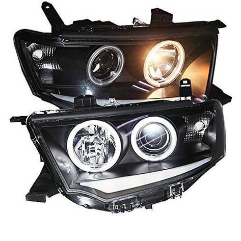 Штатная 2009 по 2013 год для Mitsubishi Pajero Sport головная оптика с LED ангельскими глазками SN, фото 2