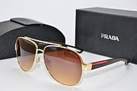 Солнцезащитные очки PRADA  550 золото кор