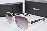 Солнцезащитные очки PRADA  550 серебро серые