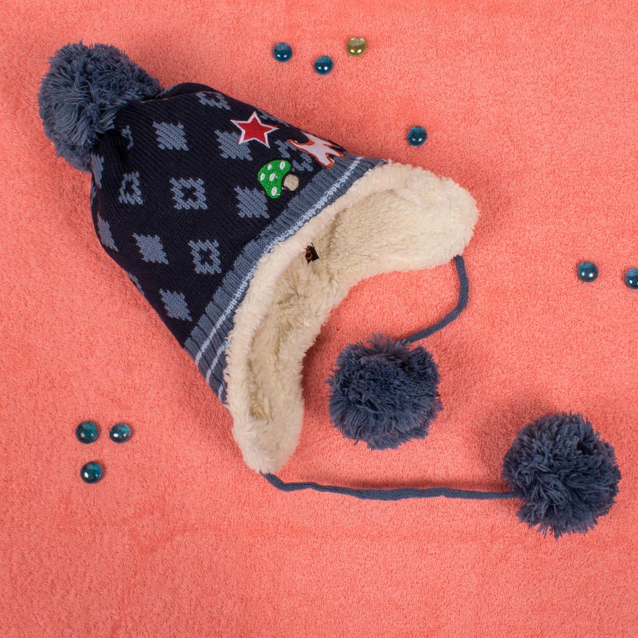 Вязаная шапка для мальчика на завязках с мехом внутри синяя CMF W16-06