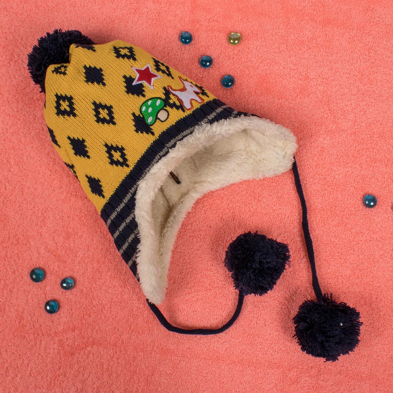Вязаная шапка для мальчика на завязках с мехом внутри желтая CMF W16-0