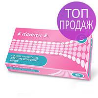 Перчатки нитроловые розовые Doman текстурированные на пальцах, неопудренные, 50пар в упаковке