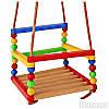 Детская качеля деревянно- пластмассовая, в сетке 30*30см