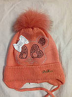 Шапка зимняя для девочки вязанная с бумбоном из натурального меха кораллового,розового,серый цвета Мишка оптом