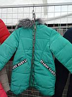 Куртка зимняя удлиненная для девочек 7-11 лет бирюзового цвета с капюшоном оптом