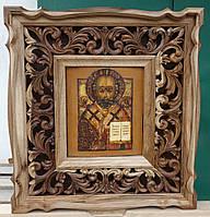 Киот для иконы фигурный из ореха, с резной деревянной рамой.