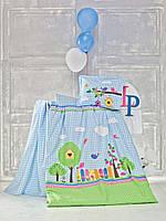 Детский набор в кроватку голубого цвета