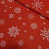 Ткань декоративная новогодняя с пропиткой с белыми снежинками на красном, ширина 150 см