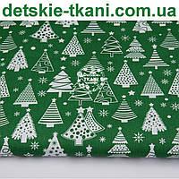 """Ткань новогодняя """"Ёлки разной формы"""" на зелёном фоне, № 1099"""