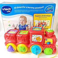 Детская музыкальная каталка паровозик Vtech поезд красный