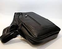 Кожаная стильная черная сумка-рюкзак через плечо (10960)