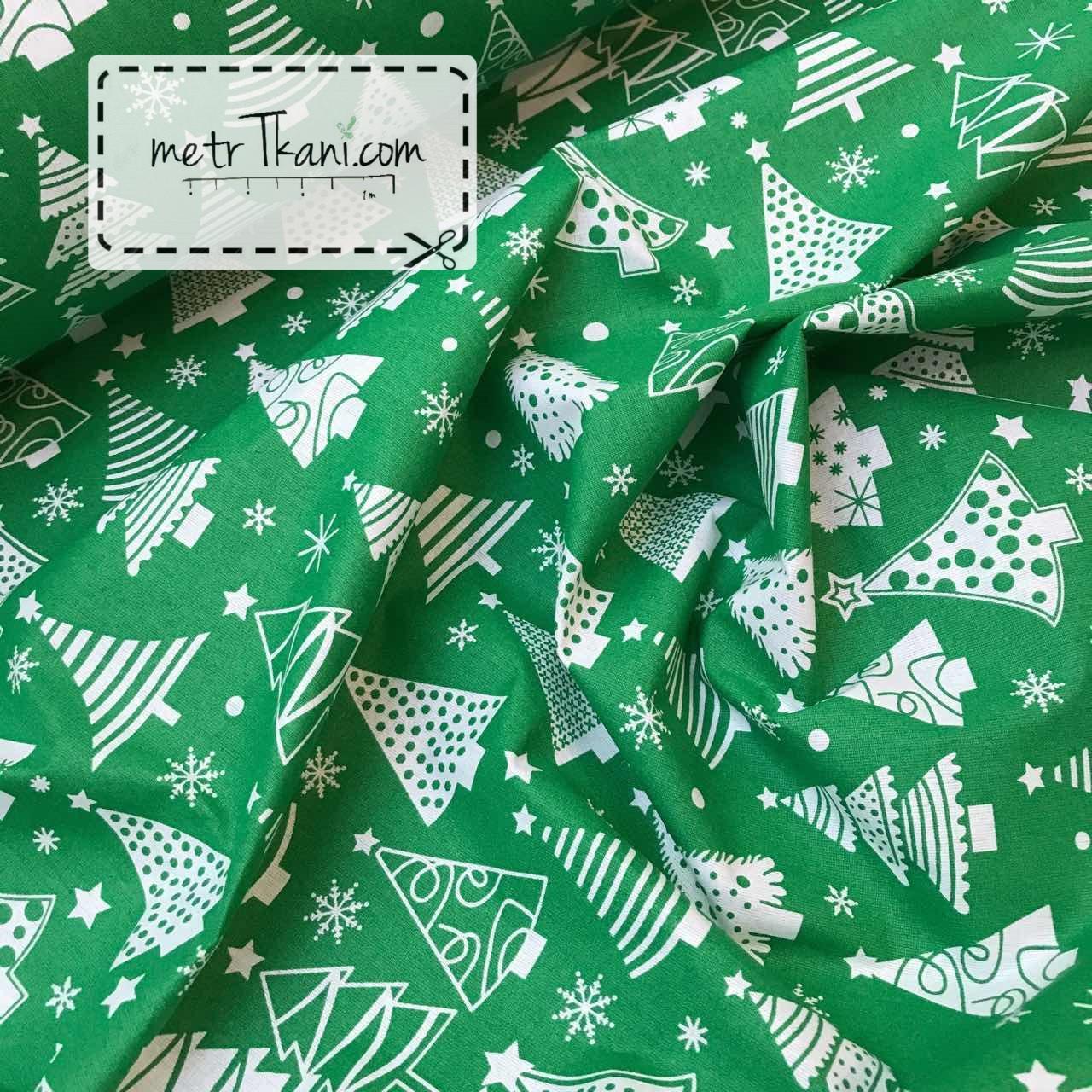 Новогодняя ткань с белые  ёлочками на зеленом фоне № 858