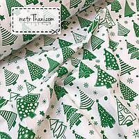 Новогодняя ткань с зелеными  ёлочками на белом фоне № 859