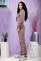 Красивый женский вязанный костюм с оригинальными узорами