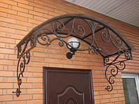 Кованый навес над входной дверью