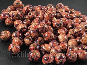 Дерев'яні намистини червоні візерунки 9 мм упаковка 100 шт