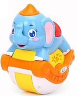 Игрушка Huile Toys Музыкальный слоник (3105C)