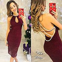 Женское вечернее платье с украшением на спине