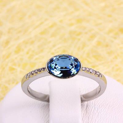 011-0030 - Кольцо Swarovski Oval Aquamarine Crystal и прозрачные фианиты родий,  19 р.