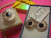 Серебряные кольцо и серьги с золотыми вставками и ониксами