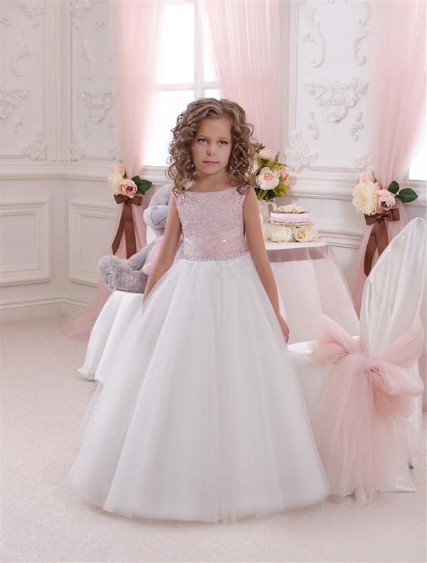 Платье с нежно-розовым лифом на молнии и пышной длинной юбкой. От года до 11 лет