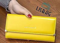 Вместительный женский желтый кошелек на кнопке хорошего качества, фото 1