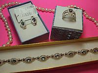 Серебряный комплект (кольцо и серьги) с фианитами
