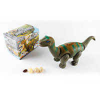 Динозавр-проектор 38см 666-3A ходит,звук,свет,несет яйца (3шт) 2цв, в коробке