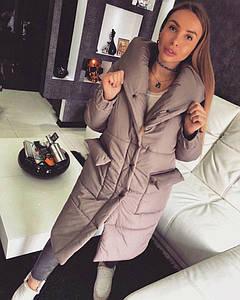 Женский зимний удлиненный пуховик с капюшоном на кнопках