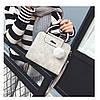 Жіноча сумка з ручками і плечовим ремінцем сіра з екошкіри