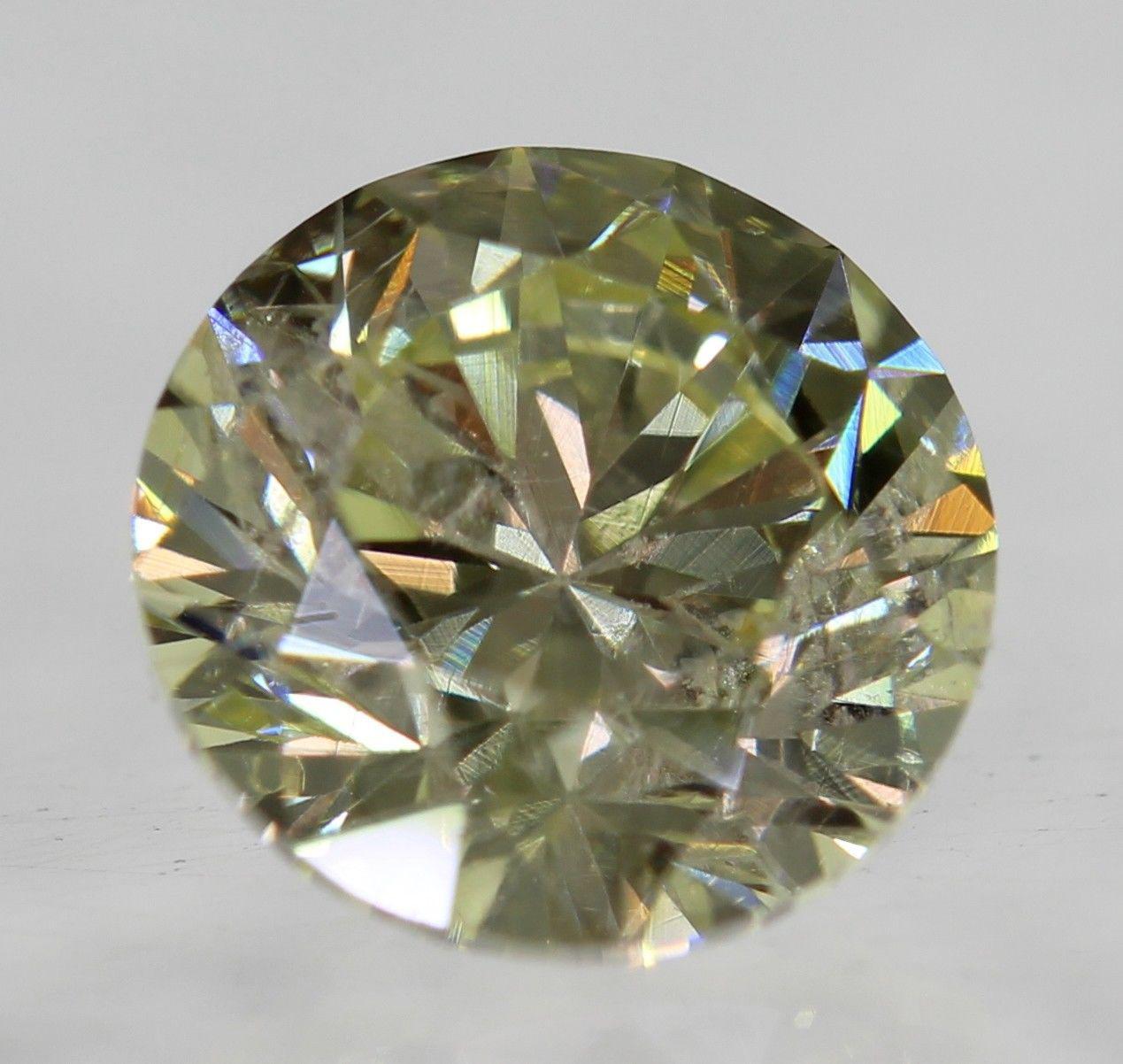 Бриллиант природный 0.74 Carat  SI1 желтый 5.62 - 5.66 X 3.69 мм
