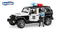 Игрушка Bruder Джип Wrangler Unlimited Rubicon Police + фигурка полицейского М1:16 (02526)