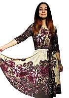 Приталенное платье  с рисунком купон.. Акция