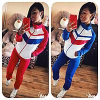 Женский модный спортивный костюм с полосками