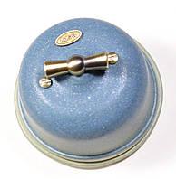 Выключатель поворотного типа 2-клавишный проходной  Lux  Jeans marini, фурнитура дерево, бронза.