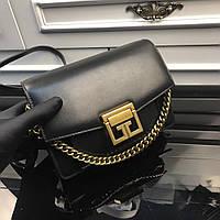 Клатч из натуральной кожи с металлическими украшениями Givenchy