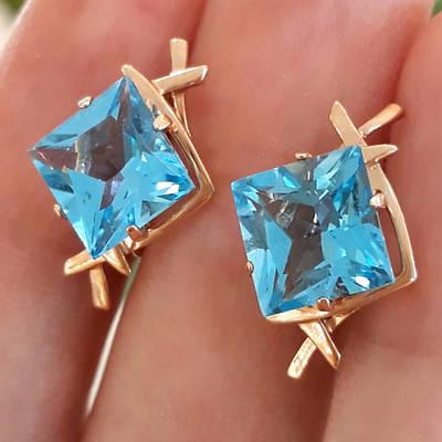 Золотые серьги с голубым топазом